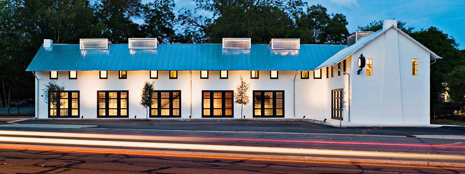 Exterior shot of John Grable Architects office building at night