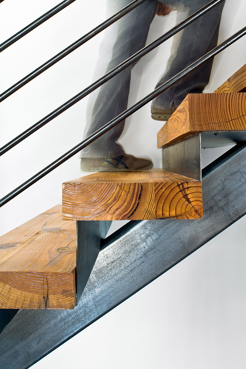 Interior shot of John Grable Architects office of someone walking up the stairs